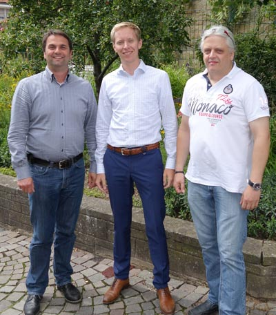 Lutz Bartl, Martin Werner and Harald Bohlinger after signing the merger